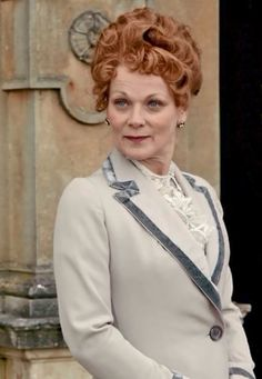 Lady Rosamund wearing a light grey suit jacket with velvet collar trim Watch Downton Abbey, Downton Abbey Fashion, Samantha Bond, Julian Fellowes, Light Grey Suits, Dowager Countess, Maggie Smith, Lady Mary, Edwardian Era