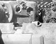 """""""Tiger"""" hit by anti-tank rounds with only what appears to be surface damage, but the crack weakens the armor and would need to be serviced. A lot of allied troops realized eventually, that a direct frontal attack to the Tiger was a poor decision, more creative ways like damaging the treads was more effective. Even then, although immobilized, the Tiger tank was still a savage, relentless force and had the potential to be just as dangerous."""