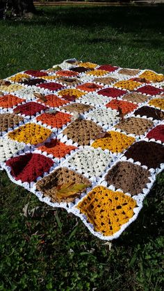 This granny square afghan was made in warm fall colors that is perfect for wrapping yourself in as the weather gets colder.  MEASUREMENTS 67 long, 63 wide  MATERIALS Made using a combination of Red Heart and Bernat 100% acrylic yarn.  WASHING INSTRUCTIONS Wash cold on gently cycle and hang o