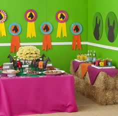 Hay topped with pieces of bright felt as self-serve bar for derby days Birthday party