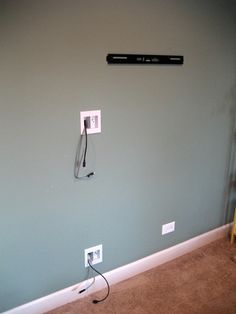 Fiscally Chic: Hiding TV Cords and Cables // off center your hanging TV power supply! genius.