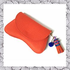 Orange wool felt clutch with unique tassel with by TOOCHEme