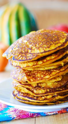 Pumpkin pancakes for Thanksgiving breakfast: moist, light, and fluffy! Healthy, full of pumpkin flavor and with just the right amount of spice!