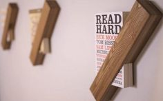 Book holders.  I envision them holding up my large art books, or my large antique books of poetry.
