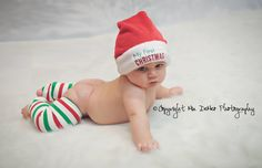 Can it get any cuter ? Baby Christmas pictures with leg warmers & Santa hat. By Mia DeMeo photography