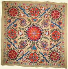 Suzani tribal textile hand embroidered on linen or silk made by tribes of central asia and given as bridal gifts for bed coverings or wall hangings.