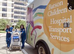 Transport nurses April Davidson, left, and Kathy Hamilton, move an isolette from the ambulance to the neonatal intensive care unit.
