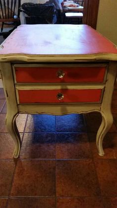Nightstand painted with Caribbean Coral and Creamy Linen Farmhouse Paint.