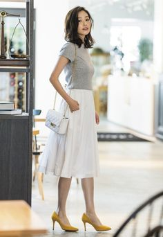 Relaxed fit tee, midi length skirt, pop of color on shoes. I wish they were an inch taller though
