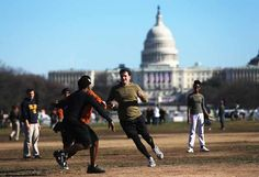 WASHINGTON, DC - JANUARY 19: People play football in front of the U.S. Capitol building as Washington prepares for President Barack Obama's second inauguration on January 19, 2013 in Washington, DC. The U.S. capital is preparing for the second inauguration of U.S. President Barack Obama, which will take place on January 21. (Photo by Mario Tama/Getty Images) Presidential Inauguration, January 21, Capitol Building, Barack Obama, Washington Dc, Presidents, Mario, Two By Two, Football