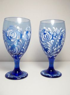 Set of two blue glassware stemware hand painted in an original design of a rosemaling, folk art style, using acrylic enamels for both beauty and durability. Non-toxic. Hand washing recommended. Artist signed. 7 H, 3 across top. 2#