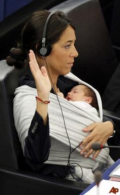 Italian Member of the European Parliament Licia Ronzulli takes part with her daughter in a voting session at the European Parliament in Strasbourg.