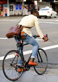 Riding down Oxford. Love. Including the bike....Luv everything about this look