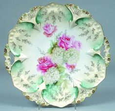 "RS PRUSSIA CAKE PLATE, 11""d.; MOLD 82; FD 31 WITH GHOST DAISIES ON BLUE-GREEN ACCENTS AND GOLD FLORAL STENCILING IN DOMES, GOLD HIGHLIGHTS TO MOLD FEATURES"