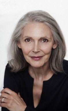 Studio portrait of middle aged woman