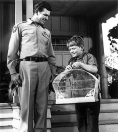 """Andy Griffith appears in a scene with Ronny Howard on """"The Andy Griffith Show."""" """"The backbone of our show was love,"""" Griffith once said. """"There's something about Mayberry and Mayberry folk that never leaves you."""""""