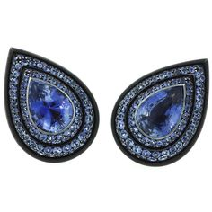 $56,000 HEMMERLE Sapphire Earrings Germany Late 20th Century A pair of earrings designed as tear drops, with pear shape sapphires at the center surrounded by descending clusters of round cut sapphires in steel on 18k gold. Signed, Hemmerle Munich