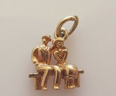 charm of a couple sitting on a park bench - hallmarked PPld Birmingham 1968