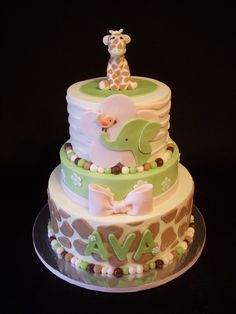 6, 8, 10 tiers iced in buttercream. Smoothing technique learned from Sugarshacks DVD. She asked me to make it match their crib bedding. MMF decorations and MMF giraffe on top.