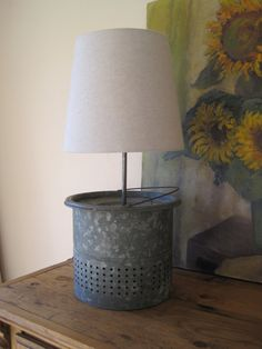 Recycled Minnow bucket lamp. Who would think? We have one of these Minnow Buckets for sale, maybe we should try this.
