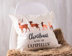 Add a woodland touch to your sofa with a stunning personalised family Christmas cushion, featuring each family member as a metallic brass effect deer.