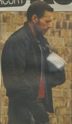 FREDDIE MERCURY - 1991 - Freddie went to see his mum every Thursday afternoon for tea, and he rarely came away empty-handed. His mum made wonderful cheese biscuits and packed them into a little lunch-box for him. In fact, in one of the last photographs the newspapers published of Freddie ↑(above)↑ he was outside Gar­den Lodge with a box of his mum's cheese biscuits under his arm.