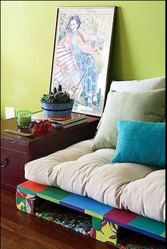 Palette furniture. Click for more photos of this colourful home in in São Paulo.