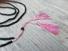 Long Tassel Necklace Black Beaded and Red by PiscesAndFishes Tassel Jewelry, Tassel Necklace, Greek Jewelry, Dainty Necklace, Pink Christmas, Necklace Lengths, Tassels, Delicate, Black Seed