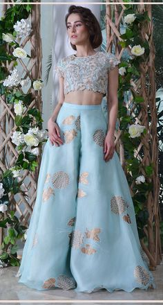 Yashodhara crop top paired with flaired palazzos Dress Indian Style, Indian Fashion Dresses, Indian Designer Outfits, Designer Dresses, Fashion Outfits, Ethnic Outfits, Indian Outfits, 10 Years Girl Dress, Anarkali