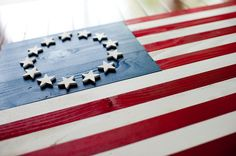 Detail on a Betsy Ross wood flag. Love the circle of stars on this flag.