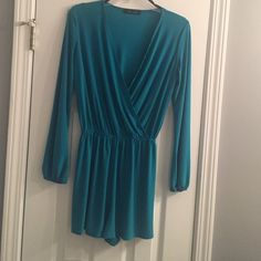 Romper - Like new - worn one time Great condition. Slinky stretch polyester. Teal color Other