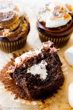 S'mores have never tasted so good! Moist and rich homemade chocolate cupcakes filled with marshmallow, topped with chocolate frosting