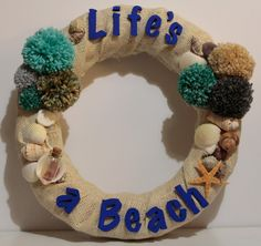 "Items similar to ""Life's a Beach"" theme decorative wreath on Etsy Beach Decorations, Beach Themes, Fancy Dress Theme Ideas, Easy Crafts, Arts And Crafts, April Wedding, Summer Wreath, Beach Party, Seashells"