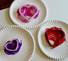 Cookie Cutter Painting   [onto brown bags = Valentine holders???]