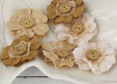 Prima burlap flowers- really pretty! Do with fabric I cut off the bottoms of the curtains and tulle.