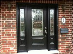 Black front door with sidelights. Brick house with black front door. Front Entrances, Victorian Front Doors, Front Door Makeover, Black Wooden Front Doors, Entry Doors With Glass, Black Front Doors, Entrance Doors, Door Makeover, Red Brick House