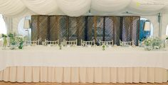The bride and groom table for this white and light green mint wedding wiht silver details...