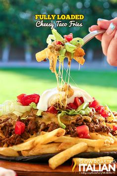 Perfectly crisp french fries topped with your favorite taco fixin's. Fully Loaded Cheesy Taco Fries are piled high fabulously flavorful seasoned beef, ooey gooey cheese and a lettuce and tomatoes. It doesn't get more kid friendly that that! Ready in just 35 minutes this simple recipe is sure to be a repeat on your menu planner.