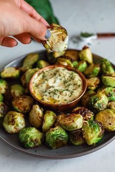 Crispy roasted brussel sprouts with a creamy dijon aioli dipping sauce - these are the perfect, simple holiday appetizer or side-dish. # Crispy Brussel Sprouts With Dijon Aioli - Dash of Mandi Veggie Recipes, Appetizer Recipes, Vegetarian Recipes, Dinner Recipes, Appetizer Ideas, Meat Appetizers, Simple Appetizers, Chicken Recipes, Steak Recipes