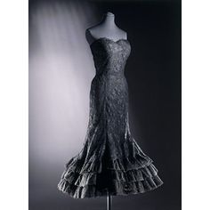 Evening dress  Place of origin: Paris, France (made)  Date: ca. 1958 (made)  Artist/Maker: Chanel, born 1883 - died 1971 (designer)  Materials and Techniques: Lace over silk and net boned foundation