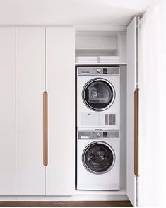 Lovely handle detail on this concealed laundry space designed by in Auckland, NZ. Essentially hiding away the laundry, by stacking our matching pair, condenser dryer and frontloader washer into a cupboard. Laundry Cupboard, Laundry Doors, Laundry Room Organization, Small Laundry Rooms, Laundry In Bathroom, Compact Laundry, Laundry In Kitchen, Küchen Design, Door Design