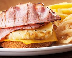 Schnitzels and seafood dishes are served with Spur-style crispy onion rings and chips OR baked potato. Replace your chips with a garden salad for a healthier alternative. Crispy Onions, Onion Rings, Seafood Dishes, Healthy Alternatives, Baked Potato, Hawaiian, Pineapple, Bacon, Sandwiches