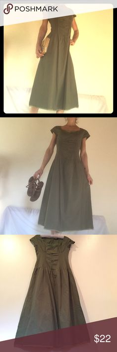 Olive green embroidered dress Long dress size small. Back zipper was repaired after it was ripped. Selling as is. More pics on request. Will model outside and update because the inside pics don't do this dress justice. Dresses