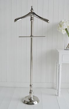 Chrome valet stand for clothes. Cottage bedroom furniture from The White Cottage - www.thewhitecottageompany.com
