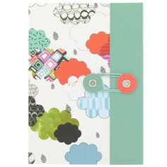 White notebook with clouds design. This notebook has a thread closure, stitched binding and plain pages for sketching and making notes. £2.50