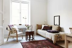 White Walls // Moroccan Side Table // White Couch // Moroccan Rug