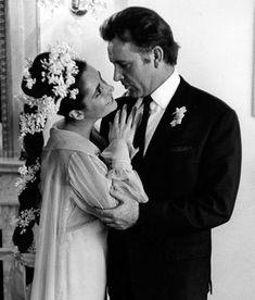 Elizabeth Taylor & Richard Burton on their first wedding day.