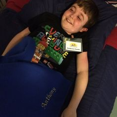 Anthony is thrilled to be in our dorm room at Canine Companions and he loves the special blanket and name tag they gave him at the beginning of our service dog training classes.  He'll never forget the summer of 2015!