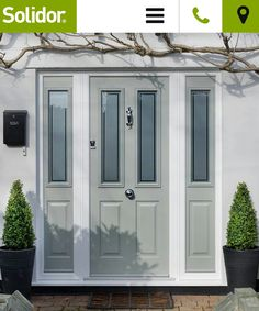 Grey green composite front door and side panels Front Door Side Windows, Front Door Porch, Grey Front Doors, Porch Doors, House Front Door, Front Door Colors, Entrance Doors, Windows And Doors, Garage Doors