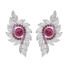 Ruby Feather earrings in white and yellow gold with rubies, sapphires and diamonds, £POA, Nirav Modi